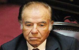 Former president Carlos Menem who should have been sitting in the dock was absent on medical prescription