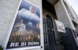 "Banners outside the San Giovanni Bosco church on the city's outskirts described him as the ""King of Rome""."