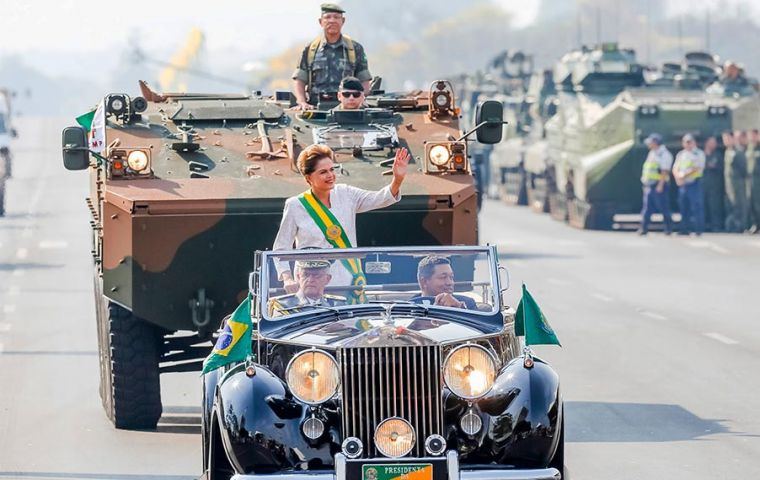 Rousseff, in the official Rolls Royce with the top down and wearing the presidential ribbon, led the military parade for 2 kilometers