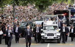 Francis waved to the crowd surging against barricades as the pope-mobile made the 15-minute trip. Some 80,000 people received tickets to the processional.