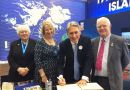 The Foreign Secretary signing the visitors' book at the Falklands stand next to FIGO representative Sukey Cameron and MLAs Jan Cheek and Roger Edwards