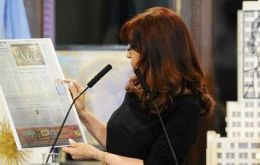 Cristina Fernandez holds the front page of the Italian newspaper