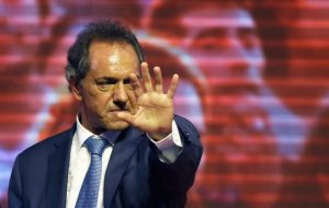 "Scioli claimed Macri plans ""a major currency devaluation, which would mean a loss of wages in real terms."""