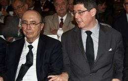 Meirelles and Finance Minister Joaquim Levy delivered speeches to business leaders in Brasilia after having lunch together