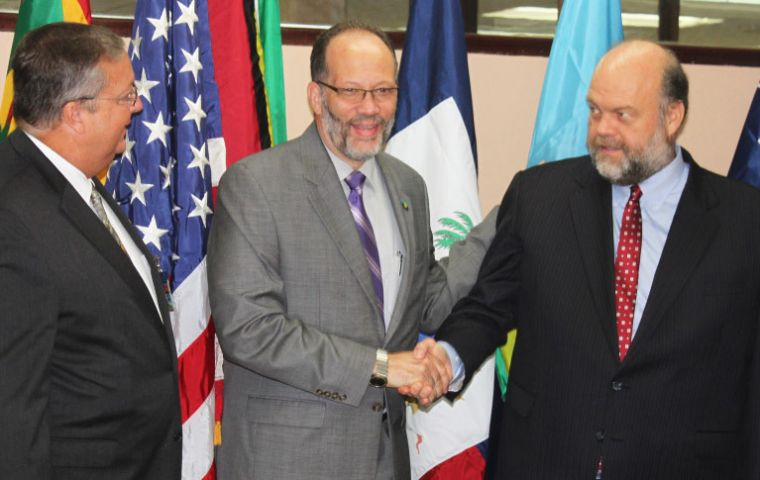 CARICOM Secretary-General Ambassador Irwin LaRocque (c) welcomes US Ambassador to CARICOM Perry Holloway to the signing ceremony, while Mission Director, USAID, Eastern and Southern Caribbean, Christo