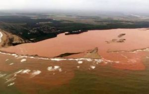 The dense orange sediment in the river reached the ocean on the weekend, hurting local tourist businesses and coastal fishing