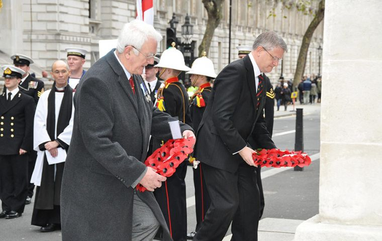 MLA Roger Edwards and Mr. Andrew Rosindell, MP laying their wreaths at the Cenotaph  (Pic P. Pepper)