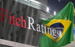 Fitch downgraded Brazil to BB+ with a negative outlook less than 24 hours after Rousseff moved to loosen next year's budget targets.