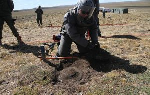 Uncovering a mine, getting it ready to be removed