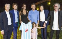 The official picture of the band with Macri, Juliana and their daughter Antonia at their country house