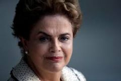 "Rousseff dug in on Friday, telling her critics there wasn't ""the slightest possibility"" she would resign and vehemently defending Lula."