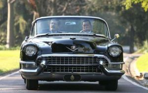 The late Chavez driving the iconic convertible Cadillac back in 2006. At the time she was working smartly