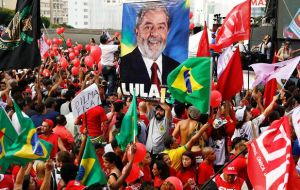 Waving the red flags of the ruling PT thousands of demonstrators took to the streets in Sao Paulo, greeting Lula with thunderous cheers