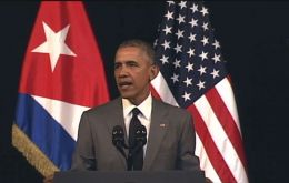 """Sí se puede"" Obama told the Cuban people promising a new beginning and recalled his 2008 slogan, ""Yes we can."""