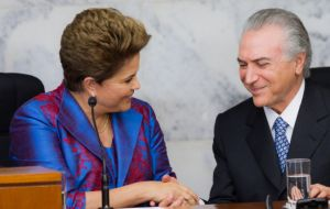 Dilma and Temer in better times share a private conversation