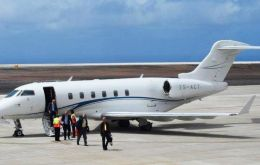 Passengers coming off the Bombardier Challenger 300. It is scheduled to depart from St Helena next Friday