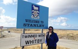 Katharine Felton next to the Stanley Welcome signpost  (Pic FB)