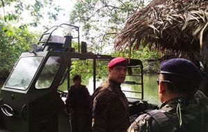 Guatemala's Defense Minister, Mansilla, was photographed on the Sarstoon River on Friday, after Guatemala deployed additional troops to the area