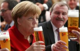 German Chancellor Angela Merkel addressed the guests praising the brewers' ingenuity in combining the four ingredients to create countless kinds of beer.