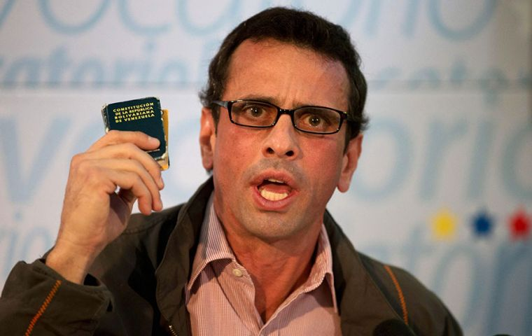 """I say to the armed forces: the moment of truth has arrived - to decide whether they are with the constitution or with Maduro,"" Capriles told a news conference."