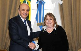Jose Serra, Brazil's new foreign minister shakes hands with Susana Malcorra at the San Martin Palace