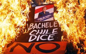 Protesters are demanding that President Michelle Bachelet speed up a long-awaited reform to guarantee universal access to free public education in Chile.