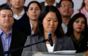 """Democratically, we accept these results,"" Fujimori said, next to the 73 lawmakers of her party that comprise the biggest parliamentary majority in two decades."