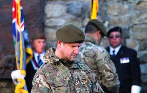 Colin Summers, a member of the Falkland Islands Defence Force, pays his respects at the Liberation Ceremony.