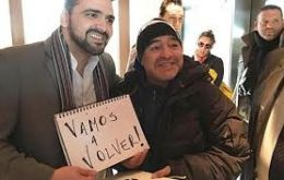"The former Argentine captain and coach Maradona with Ushuaia mayor Vuoto and the ""We'll return"" poster"