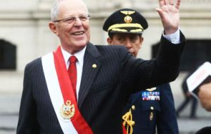 Following his inauguration, Kuczynski waved and blew kisses to supporters as he walked through Lima's historic center wearing the red-and-white presidential sash.
