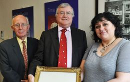 Former Governors David Tatham, Donald Lamont and Museum Director Leona Roberts display the painting - Pic Peter Pepper