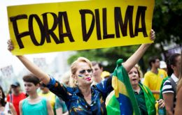 "At the Rio rally some with Brazil's flag draped over their shoulders and  wearing the national colors of yellow and green, chanted ""Out Dilma! Out corruption!"""