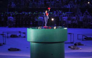 Prime Minister Shinzo Abe and Super Mario emerge from a green pipe in the middle of the Maracana Arena
