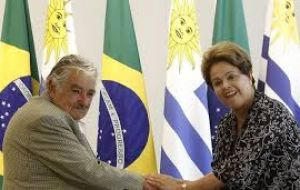 The removed Brazilian president with a long time friend, Jose Mujica  during an official ceremony