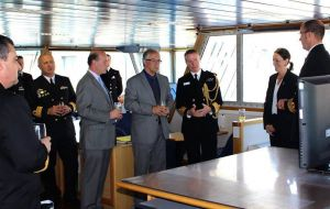 Defense minister Jorge Menendez (with glasses) and officers hosted by Captain Angus Essenhigh RN at the bridge of the visiting vessel