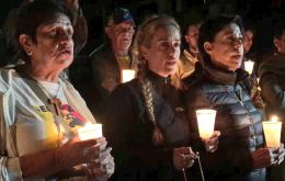 Lilian Tintori holds candlelight vigil outside the prison building where her husband is under arrest.