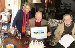 Sir Cosmo with the painting delivered by FIGO representative Sukey Cameron, MBE at his home in Ireland