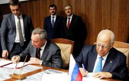 Russia's Deputy PM Dmitry Rogozin (left) and Cuban Vicepresident Ricardo Cabrisas during the signing of the agreements Friday in Havana