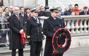 Second Sea Lord, Vice Admiral Jonathan Woodcock goes forward to lay his wreath.
