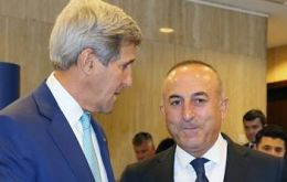 US Secretary of State John Kerry (left) discussed Monday's killing of the Russian Ambassador to Ankara with his Turkish counterpart Mevlut Cavosoglu (right) on the telephone