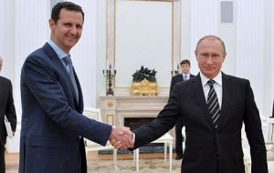 Russian President Vladimir Putin (R), a key ally of Syrian President Bashar al-Assad (L), announced the ceasefire on Thursday after forging the agreement with Turkey