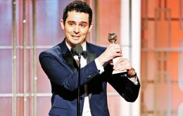 """I'm in a daze now officially,"" said the force behind ""La La Land,"" Damien Chazelle, 31, as he accepted the directing award."