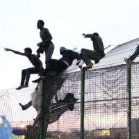 Hundreds of migrants break into Spain's North Africa territories