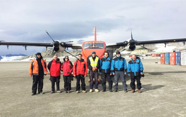 The bi-national team at Rothera next to the aircraft used for the inspection tour