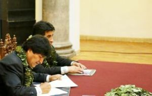 Morales signed a law which officially recognizes as legal 22,000 hectares of coca crops, raising the limit of 12,000 hectares fixed in the previous law.
