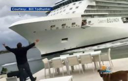 As the 16-deck, 122,000-ton Celebrity Equinox cruise ship loomed over the Todhunter's back patio, the alarmed couple recorded video of the scene
