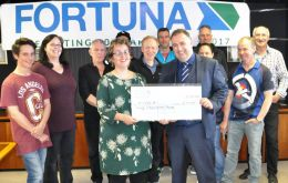 FIOGA representative receives the £ 30.000 check from Fortuna Ltd