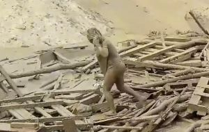 Evangelina Chamorro emerged near a bridge, lifting herself from a current of wooden planks and walking toward the shore covered head to toe in mud.