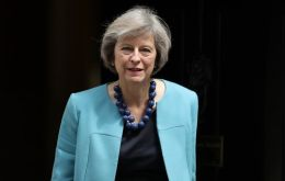"Earlier in the day, May stressed the importance of maintaining Britain's ""strength and stability"" as Britain prepares to leave the European Union."