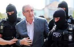 The former Lower House speaker's defense team said they would appeal the decision but Cunha will remain imprisoned pending appeal.